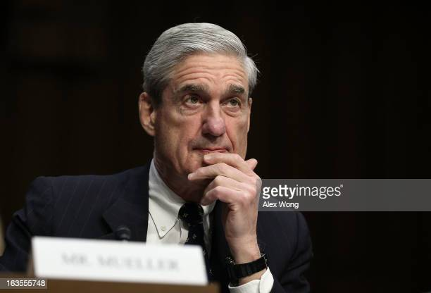 Director Robert Mueller testifies during a hearing before the Senate Intelligence Committee March 12 2013 on Capitol Hill in Washington DC The...