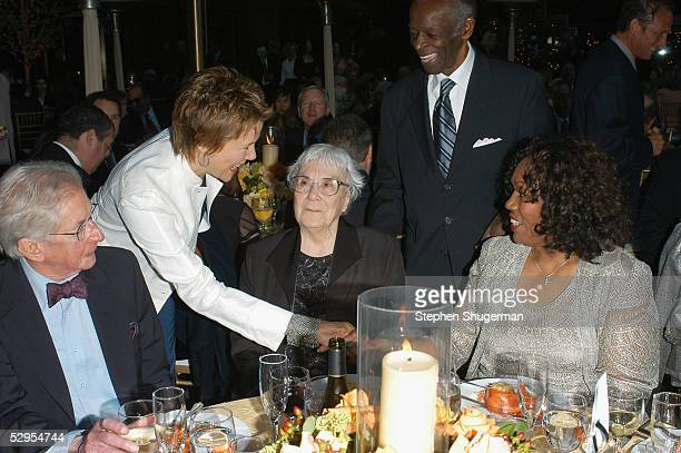 Director Robert Mulligan actress Annette Bening writer Harper Lee actor Brock Peters and Marilyn Peters attend the Library Foundation of Los Angeles...