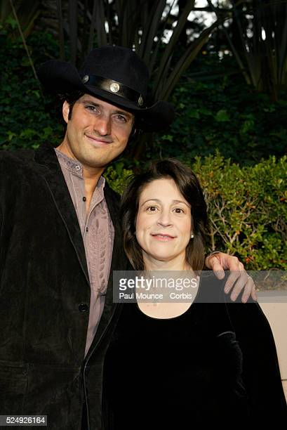 Director Robert Rodriguez and wife writer Elizabeth Avellan arrive at the Miramax PreOscar 2004 Max Awards party at the StRegis Hotel