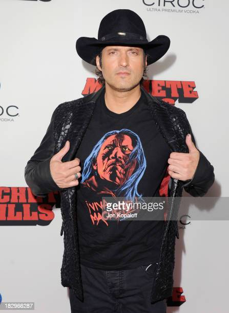 """Director Robert Rodriguez arrives at the Los Angeles Premiere """"Machete Kills"""" at Regal Cinemas L.A. Live on October 2, 2013 in Los Angeles,..."""