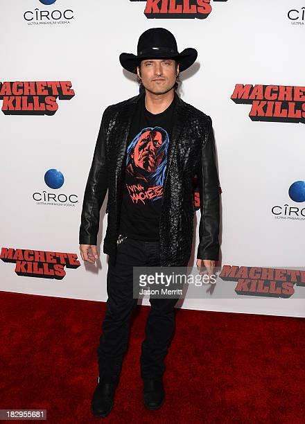 Director Robert Rodriguez arrives at the premiere of Open Road Films' Machete Kills at Regal Cinemas LA Live on October 2 2013 in Los Angeles...