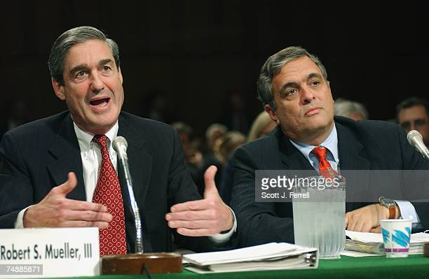 Director Robert S. Mueller III, left, and CIA Director George J. Tenet testify during the Senate Governmental Affairs hearing on President Bush's...
