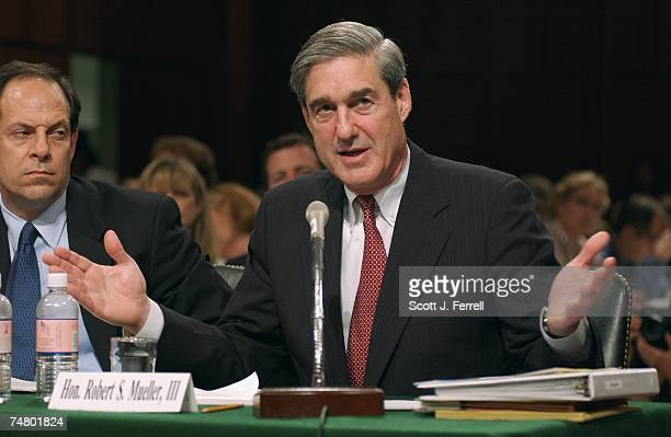 Director Robert S Mueller III right and Glenn A Fine inspector general US Department of Justice listen to members' opening statements during the...
