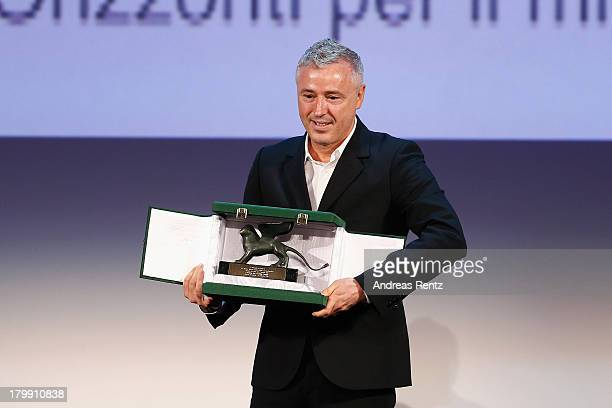 Director Robin Campillo poses on stage with the Orizzonti Award for Best Film he received for his movie 'Eastern Boys' at the Closing Ceremony during...