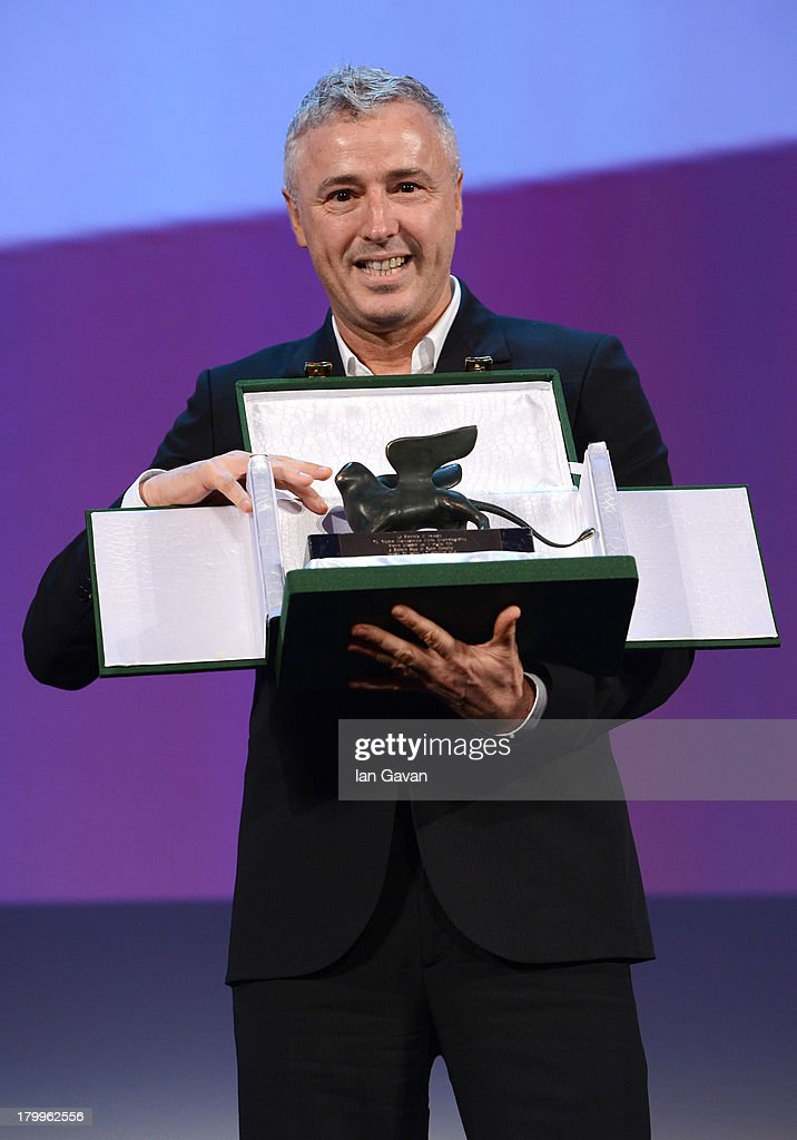 Director Robin Campillo poses on stage with the Orizzonti Award for Best Film he received for his movie 'Eastern Boys' on stage during the Closing Ceremony at the 70th Venice International Film Festival at the Palazzo del Casino on September 7, 2013 in Venice, Italy.