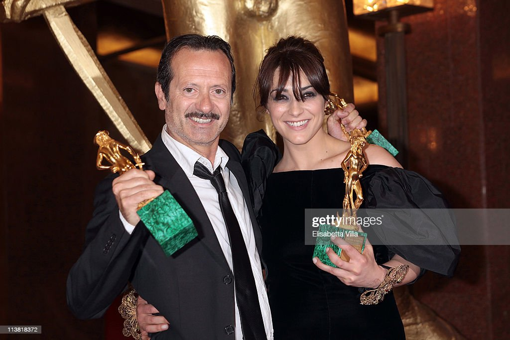 Director Rocco Papaleo (L) and actress Valentina Lodovini show their awards at the end of 2011 Premi David di Donatello Italian Academy Awards at Auditorium della Conciliazione on May 6, 2011 in Rome, Italy.