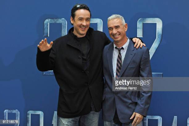 Director Roland Emmerich and actor John Cusack attend '2012' photocall at Hotel de Rome on September 28 2009 in Berlin Germany