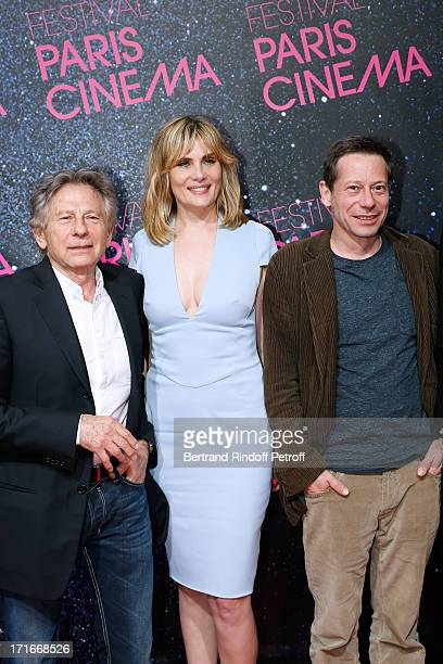 Director Roman Polanski actress Emmanuelle Seigner and actor Mathieu Amalric pose at Festival Paris Cinema Opening night and premiere of 'La Venus a...
