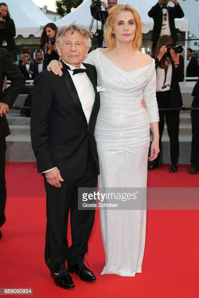 Director Roman Polanski and actress Emmanuelle Seigner leave the Based On A True Story screening during the 70th annual Cannes Film Festival at...