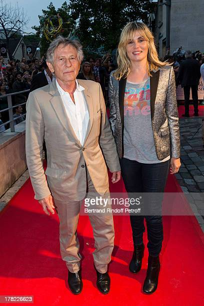 Director Roman Polanski and his wife actress Emmanuelle Seigner arrive to the Paris premiere of 'Blue Jasmine' at UGC Cine Cite Bercy on August 27...