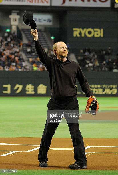 Director Ron Howard gestures to the crowd during the ceremonial first pitch prior to the professional baseball match between Yomiuri Giants and...