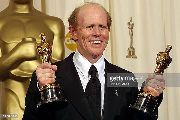 US director Ron Howard holds his Oscar for best director and for best picture for the movie 'A Beautiful Mind' 24 March 2002 at the 74th Academy...