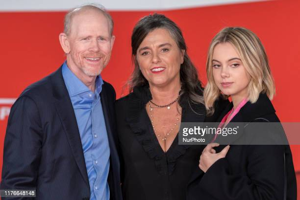 Director Ron Howard, left, poses with Pavarotti's daughter Giuliana Pavarotti, center, and grandaughter Caterina Lo Sasso, on the red carpet of the...