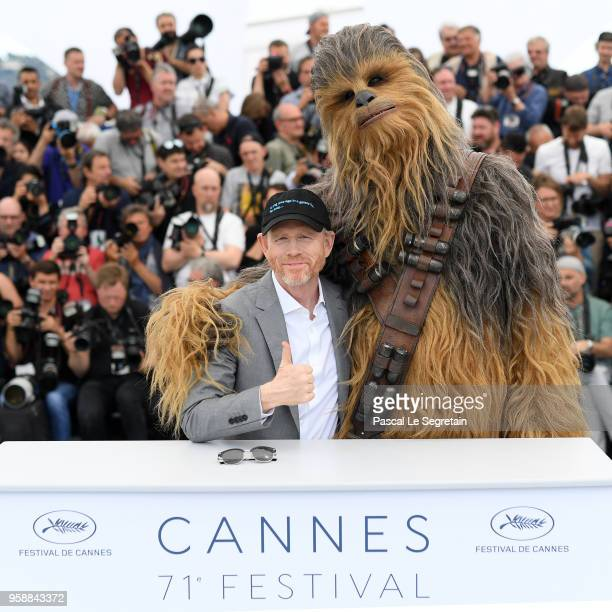 Director Ron Howard poses with Chewbacca at the photocall for Solo A Star Wars Story during the 71st annual Cannes Film Festival at Palais des...