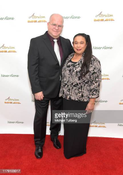 """Director Ronnie Michael and executive producer Diana Michael attend the premiere of the film """"Never Alone"""" at Arena Cinelounge on October 04, 2019 in..."""