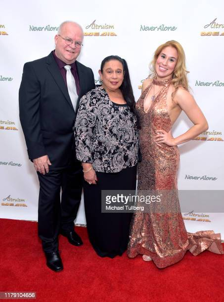 """Director Ronnie Michael, executive producer Diana Michael and Actor Ariel Michael attend the premiere of the film """"Never Alone"""" at Arena Cinelounge..."""