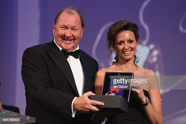 Director Roy Andersson poses after receiving the Golden Lion Award for Best Film for 'A Pigeon Sat On A Branch Reflecting On Existence' with a...