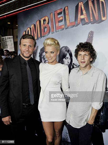 Director Ruben Fleischer actors Amber Heard and Jesse Eisenberg arrive at the premiere of Sony Pictures' 'Zombieland' at the Chinese Theater on...