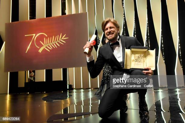 CANNES FRANCE MAY28 Director Ruben Ostlund celebrates on stage with the Palme d'Or won for the movie 'The Square' during the Closing Ceremony during...