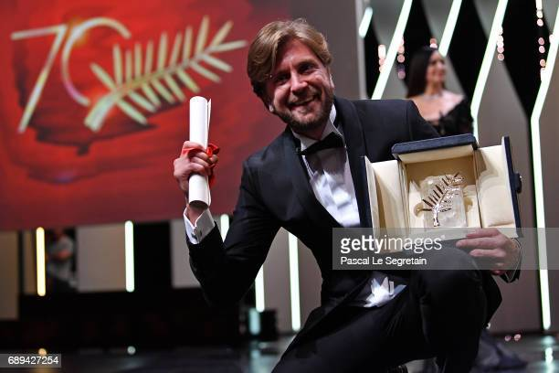 Director Ruben Ostlund celebrates on the stage after he receives the Palme d'Or for the movie The Square at the Closing Ceremony during the 70th...