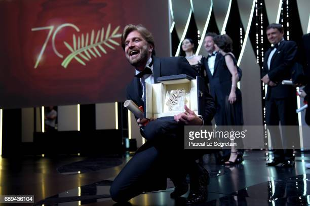 Director Ruben Ostlund celebrates on the stage after receiving the Palme d'Or for the movie 'The Square' at the Closing Ceremony during the 70th...