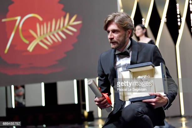 Director Ruben Ostlund poses with the Palme d'Or for the movie 'The Square' during the Closing Ceremony during the 70th annual Cannes Film Festival...