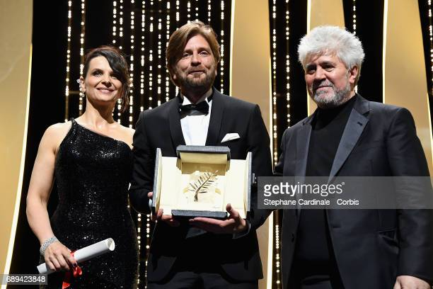 Director Ruben Ostlund poses with the Palme d'Or won for the movie 'The Square' with Juliette Binoche and President of the jury Pedro Almodovar...