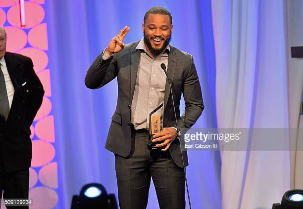 Director Ryan Coogler accepts the award for Best Integenerational Movie for 'Creed' onstage at the AARP's 15th Annual Movies For Grownups Awards at...