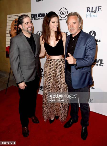 Director S Craig Zahler actress Jennifer Carpenter and actor Don Johnson arrive at the premiere of RLJE Films' 'Brawl In Cell Block 99' at the...