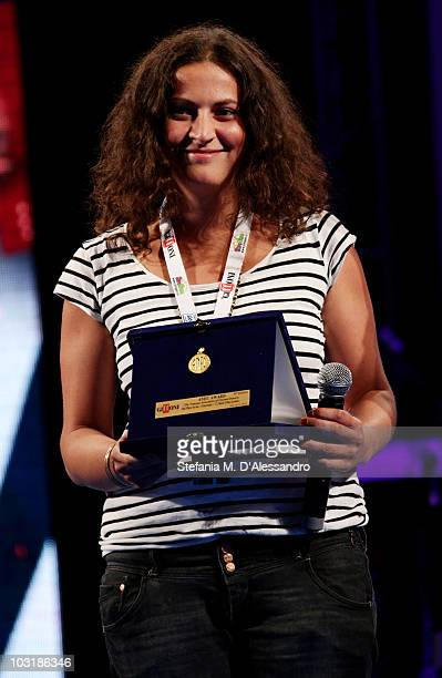 Director Sabrina Sarabi poses with the Anec Award during the closing ceremony of the Giffoni Experience 2010 on July 31 2010 in Giffoni Valle Piana...