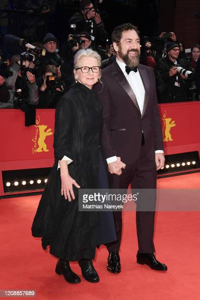 """Director Sally Potter and Javier Bardem pose at the """"The Roads Not Taken"""" premiere during the 70th Berlinale International Film Festival Berlin at..."""