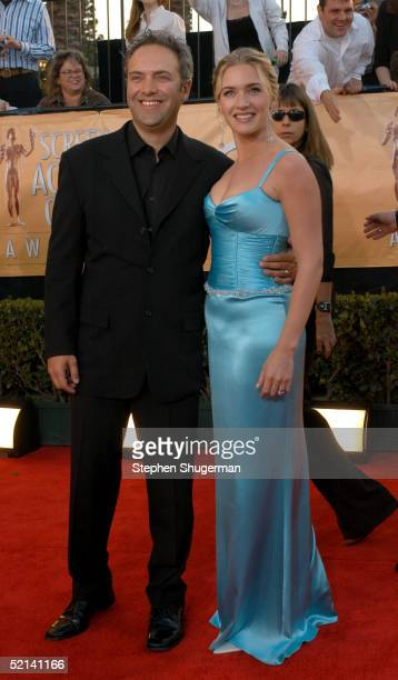 Director Sam Mendes and wife actress Kate Winslet arrive at the 11th Annual Screen Actors Guild Awards at the Shrine Exposition Center on February 5,...