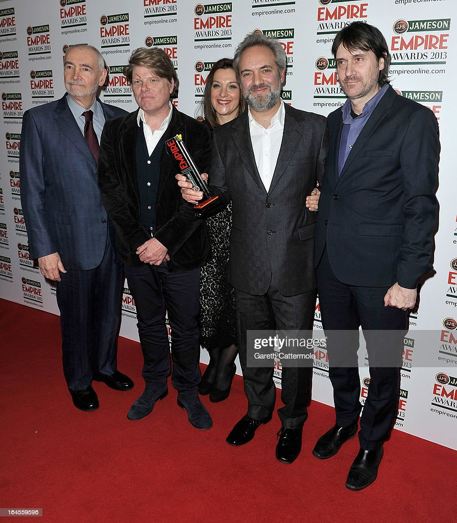 Director Sam Mendes (second right) with the Best Film award for 'Skyfall' with producers Michael G Wilson (L) and Barbara Broccoli (C) and guests at the Jameson Empire Awards 2013 at Grosvenor House on March 24, 2013 in London, England.