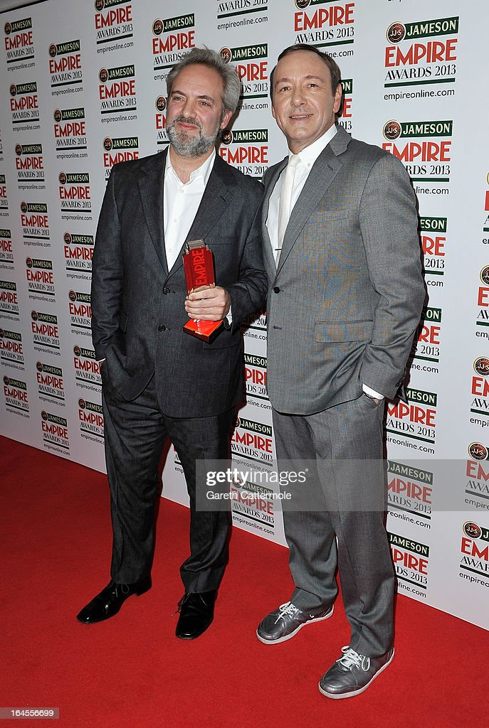Director Sam Mendes with the Empire Inspiration award presented by actor Kevin Spacey at the Jameson Empire Awards 2013 at Grosvenor House on March 24, 2013 in London, England.