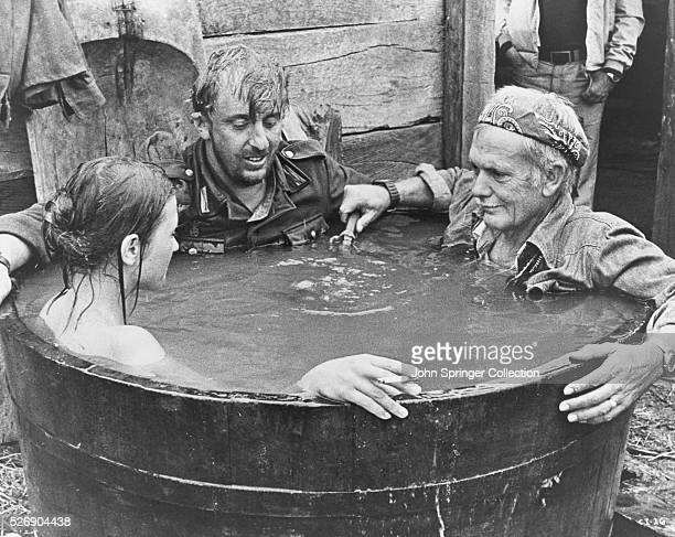 Director Sam Peckinpah demonstrates for German actor Vadim Glowna how to play this scene in the controversial director's first film dealing with...