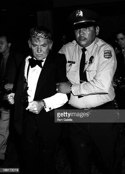 Director Sam Peckinpah escorted out of 2nd Annual American Film Institute Lifetime Achievement Awards Honoring James Cagney on March 13 1974 at the...