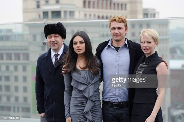 Director Sam Raimi and actors Mila Kunis James Franco and Michelle Williams during a photocall before Walt Disney Pictures Moscow premiere of 'Oz The...