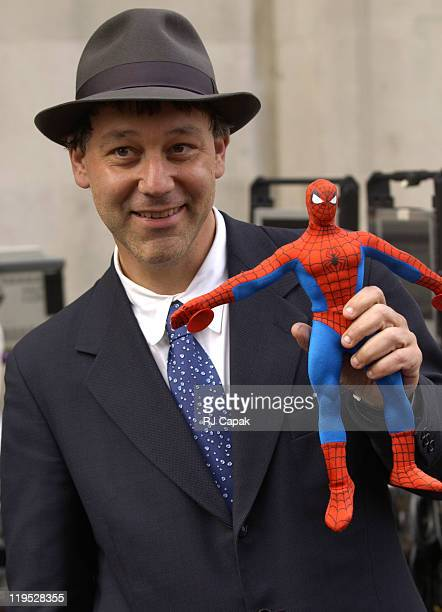 Director Sam Raimi poses with SpiderMan doll during Filming of 'SpiderMan 2' on Location in Manhattan at Streets of Manhattan in New York City New...