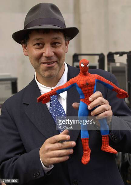 Director Sam Raimi poses with SpiderMan doll during Filming of 'SpiderMan 2' on Location in Manhattan at the Streets of Manhattan in New York City NY