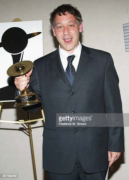 Director Sam Raimi poses with trophy after being honored during the 31st Annual Saturn Awards at the Universal Hilton Hotel on May 3 2005 in Los...