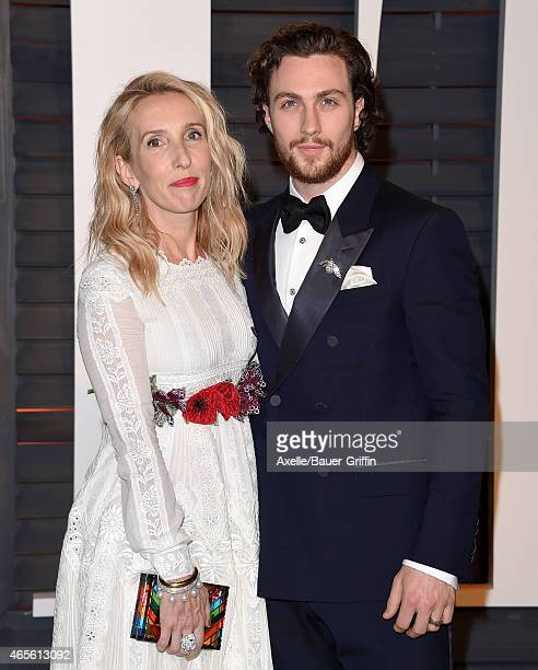 Director Sam TaylorJohnson and actor Aaron TaylorJohnson arrive at the 2015 Vanity Fair Oscar Party Hosted By Graydon Carter at Wallis Annenberg...