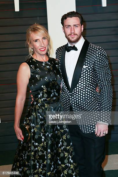 Director Sam TaylorJohnson and actor Aaron TaylorJohnson arrive at the 2016 Vanity Fair Oscar Party Hosted by Graydon Carter at the Wallis Annenberg...