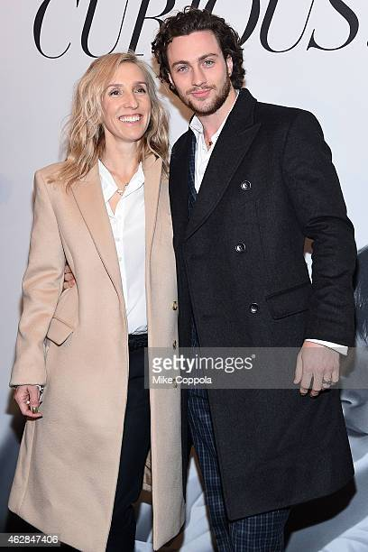 Director Sam TaylorJohnson and actor Aaron TaylorJohnson attend the 'Fifty Shades Of Grey' New York Fan First screening at Ziegfeld Theatre on...
