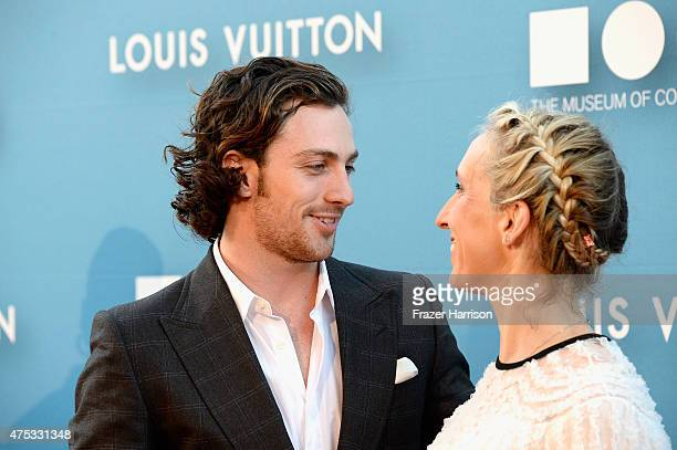 Director Sam TaylorJohnson and actor Aaron TaylorJohnson attend the 2015 MOCA Gala presented by Louis Vuitton at The Geffen Contemporary at MOCA on...
