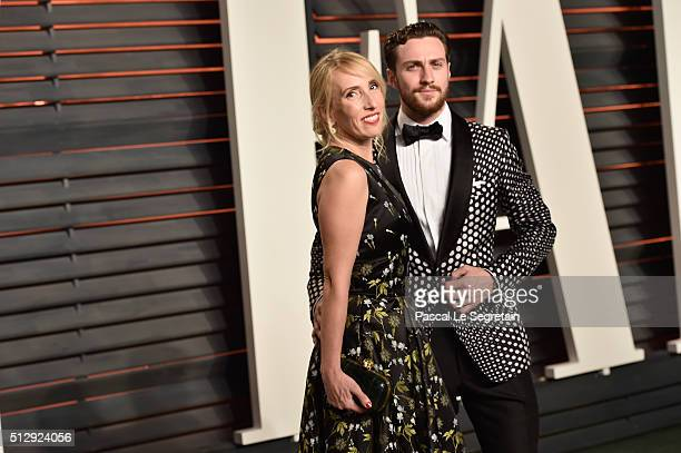 Director Sam TaylorJohnson and actor Aaron TaylorJohnson attend the 2016 Vanity Fair Oscar Party Hosted By Graydon Carter at the Wallis Annenberg...
