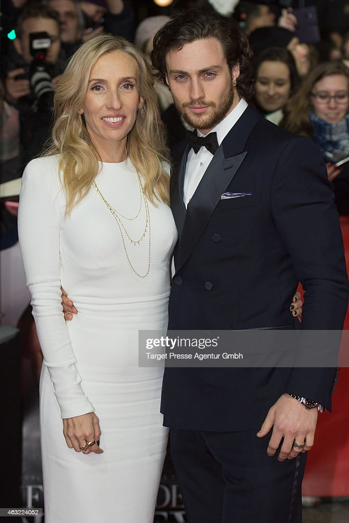 Director Sam Taylor-Johnson and her husband Aaron attend the 'Fifty Shades of Grey' premiere during the 65th Berlinale International Film Festival at Zoo Palast on February 11, 2015 in Berlin, Germany.