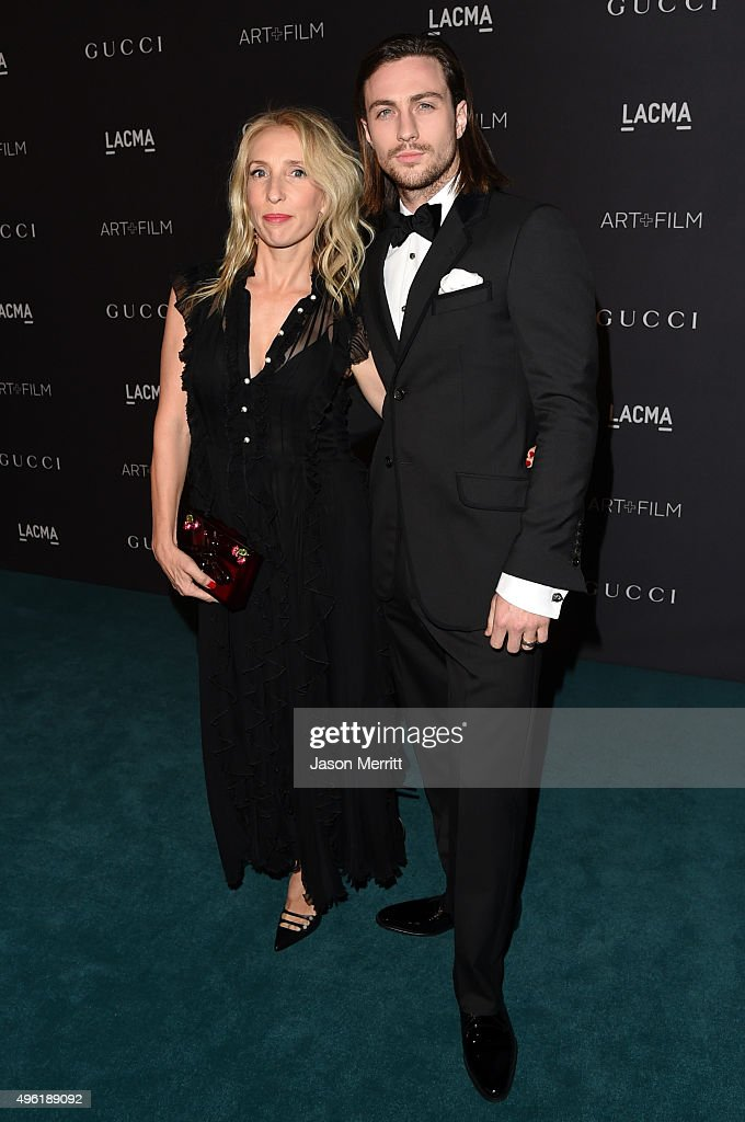 Director Sam Taylor-Johnson, wearing Gucci, (L) and actor Aaron Taylor-Johnson attends LACMA 2015 Art+Film Gala Honoring James Turrell and Alejandro G Iñárritu, Presented by Gucci at LACMA on November 7, 2015 in Los Angeles, California.