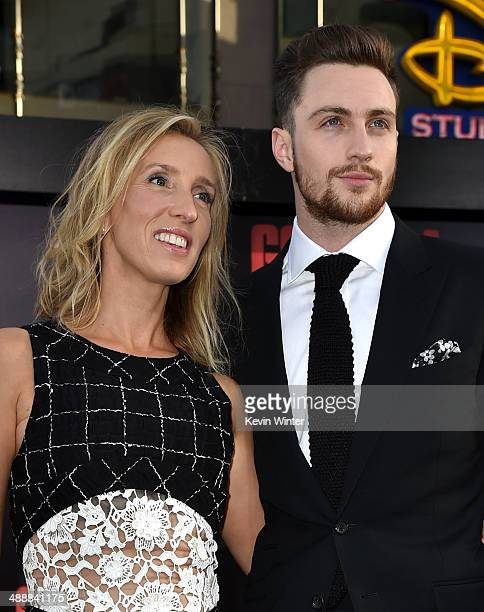 Director Sam TaylorWood and actor Aaron TaylorJohnson attend the premiere of Warner Bros Pictures and Legendary Pictures' 'Godzilla' at Dolby Theatre...