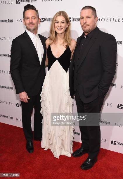 Director Scott Cooper actors Rosamund Pike and Christian Bale attend 'Hostiles' New York premiere at Metrograph on December 18 2017 in New York City
