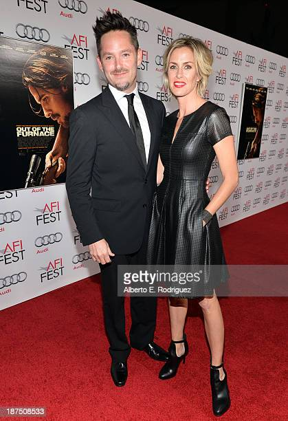 Director Scott Cooper and Jocelyne Cooper attend the screening of Out of the Furnace during AFI FEST 2013 presented by Audi at TCL Chinese Theatre on...